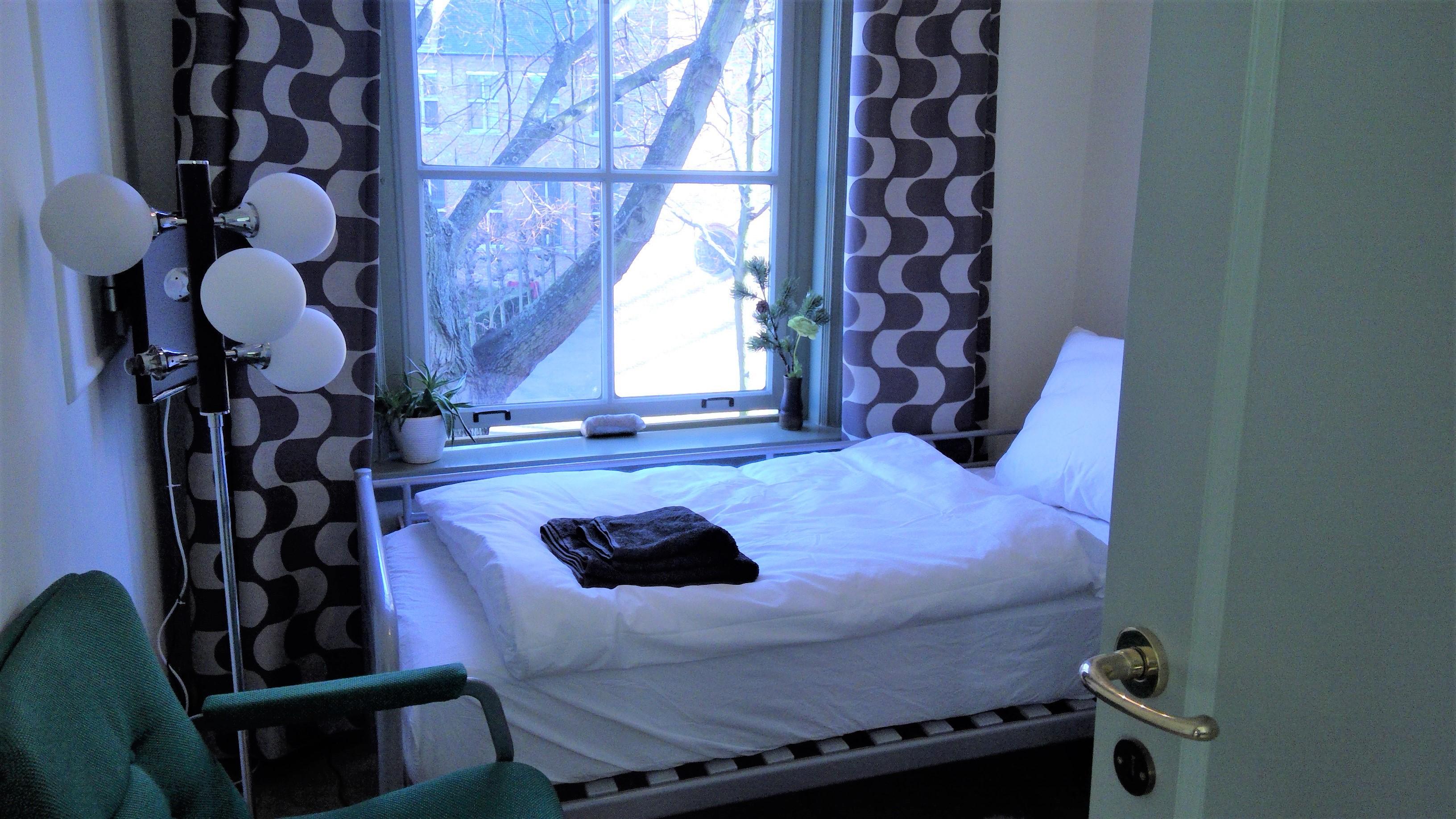 1persoonskamer met comfortabel bed